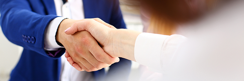 Family lawyer shakes hand of a new client